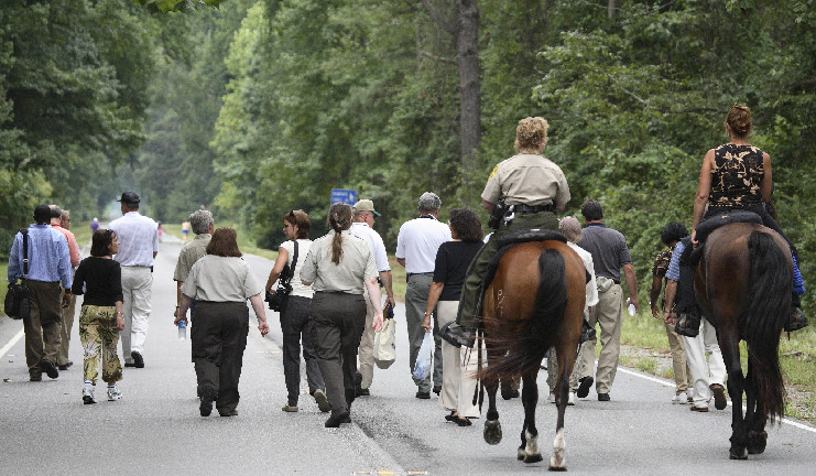 Picture of People and Horses on Trail