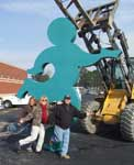 Larry Bage's running figure statue being installed - photograph