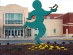 Larry Bage's running figure statue in front of the Dr. Clarence V. Cuffee Community Center - photograph