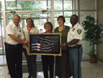 Fire Chief Best and Police Chief Wright accept the piece - photograph