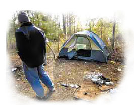 homeless man in woods with tent