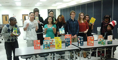Youth with Donated Dr. Suess Books