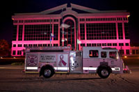Thumbnail photo of the Pink Fire Truck at night in front of City Hall