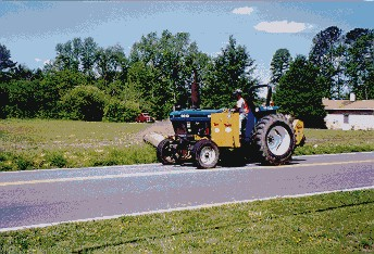 Public Works mowing with tractor