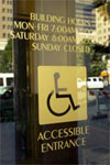 Accessible Entrance sign on building glass door