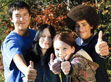 group of teens with their thumbs' up